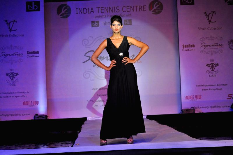 A model showcases fashion designer Manish Sharma's creations at Signature Style Fashion Voyage in New Delhi on Aug 9, 2014.