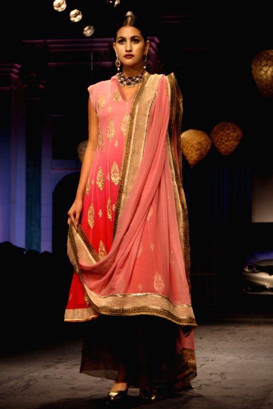 A model showcases fashion designer Meera Muzaffar Ali's creations during `BMW India Bridal Fashion Week 2014` in New Delhi on Aug 10, 2014.