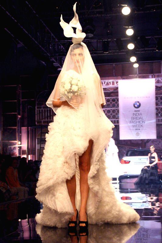 A model showcases fashion designers Gauri and Nainika's creations during  `BMW India Bridal Fashion Week 2014` in New Delhi on Aug 7, 2014.