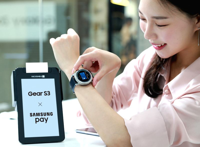 A model showcases Samsung Electronics Co.'s Gear S3 smartphone connected to the mobile transaction system Samsung Pay, allowing users to make payments using the wearable instead of taking out ...