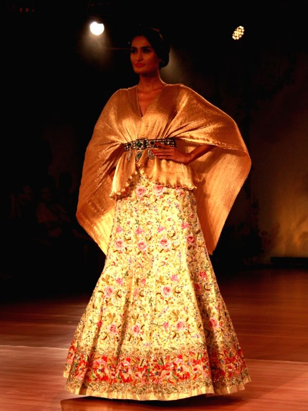 A model showcases  the creation of designer Pallavi Jaikishan at India Couture Week 2018 , in New Delhi on July 26,2018.