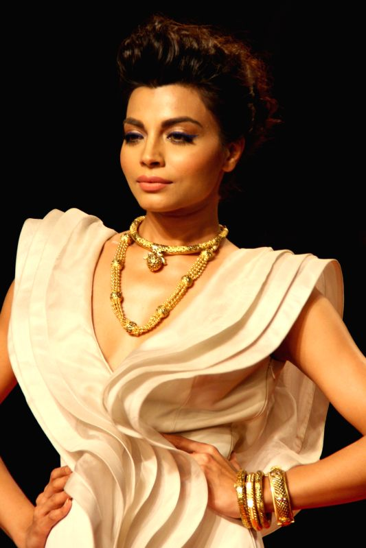 A model showcasing AZVA creations during `BMW India Bridal Fashion Week 2014`, in New Delhi on August 09, 2014.