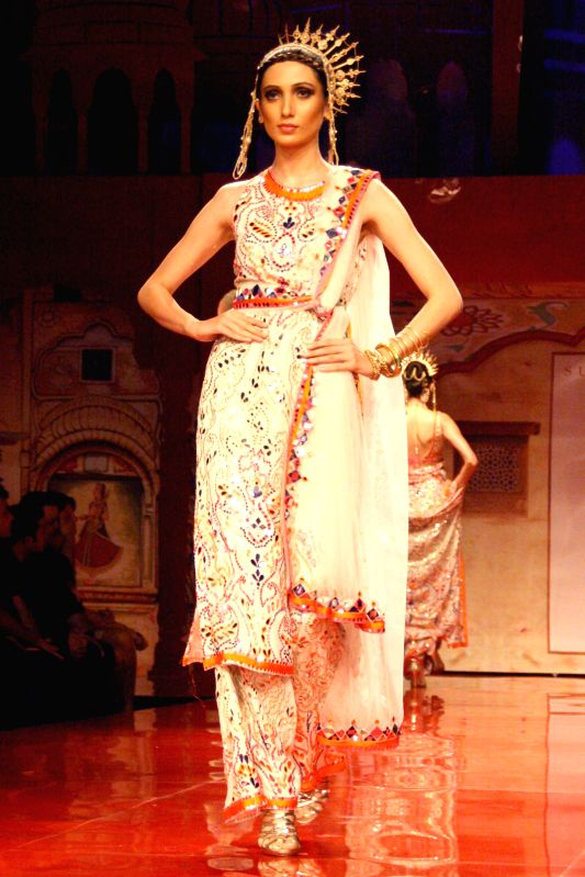 A Model showcasing designer Suneet Verma's creation during `BMW India Bridal Fashion Week 2014`, in New Delhi on August 09,2014.