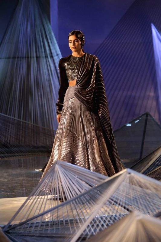 A model walk the ramp for Designer Amit Aggarwal at India Couture Week 2018 in New Delhi on July 27, 2018.