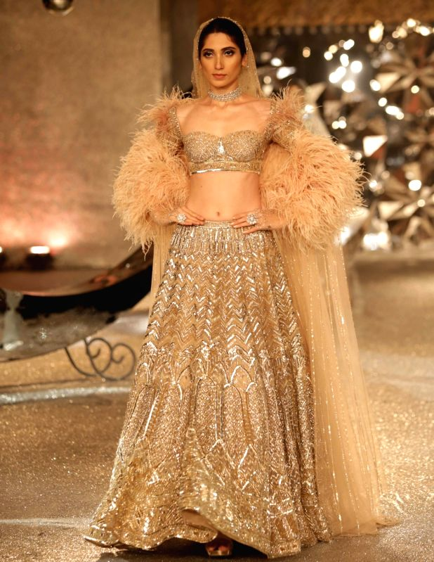 A model walk the ramp for designer duo Falguni and Shane Peacock at India Couture Week 2018 in New Delhi on July 26, 2018.
