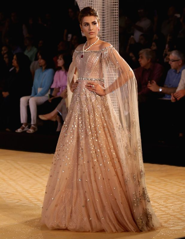 A Model walk the ramp for designer Tarun Tahiliani at India Couture Week 2018 in New Delhi on July 25, 2018.