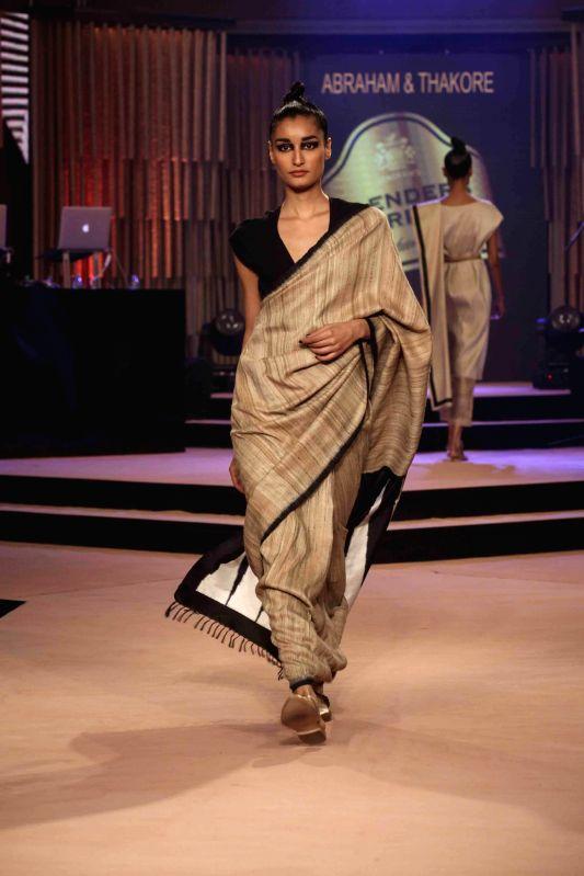 A model walks on the ramp during Blenders Pride Fashion Tour 2014 in Kolkata on Dec. 13, 2014.