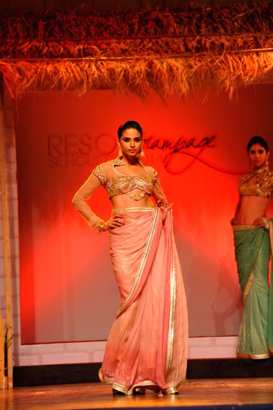 A model walks on the ramp during the Resort Rampage- Silhouettes 2014, annual fashion show organised by the students of B D Somani Institute of Art and Fashion Technology in Mumbai, on May 4, 2014.