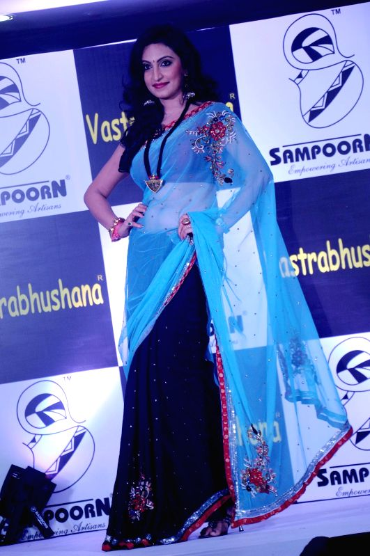 A model walks on the ramp during `Vastrabhushana - 2014` in Bangalore on July 9, 2014.