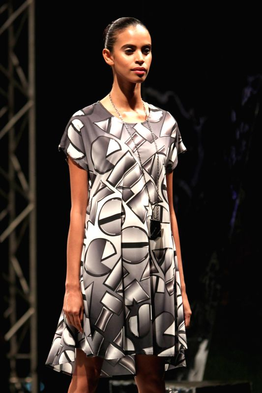 A model walks on the ramp for British designer Giles Deacon and Koovs.com at British High Commissioner`s Residence`s, in New Delhi on 23rd April 2015.