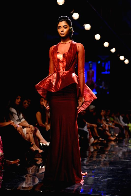 A model walks on the ramp for designer Amit Agarwal during the Lakme Fashion Week (LFW) Winter/ Festive 2014 in Mumbai, on Aug. 19, 2014.