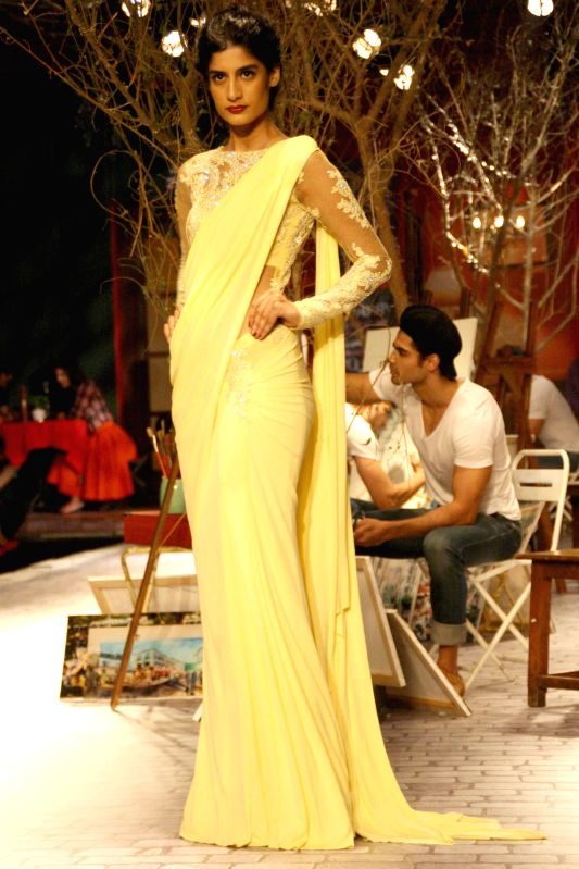 A model walks on the ramp for designer Monisha Jaising`s show during India Couture Week 2014, in New Delhi on July 17, 2014.