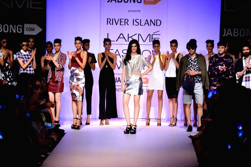 A model walks on the ramp for designer River Island during the Lakme Fashion Week (LFW) Winter/ Festive 2014 in Mumbai, on Aug. 20, 2014.