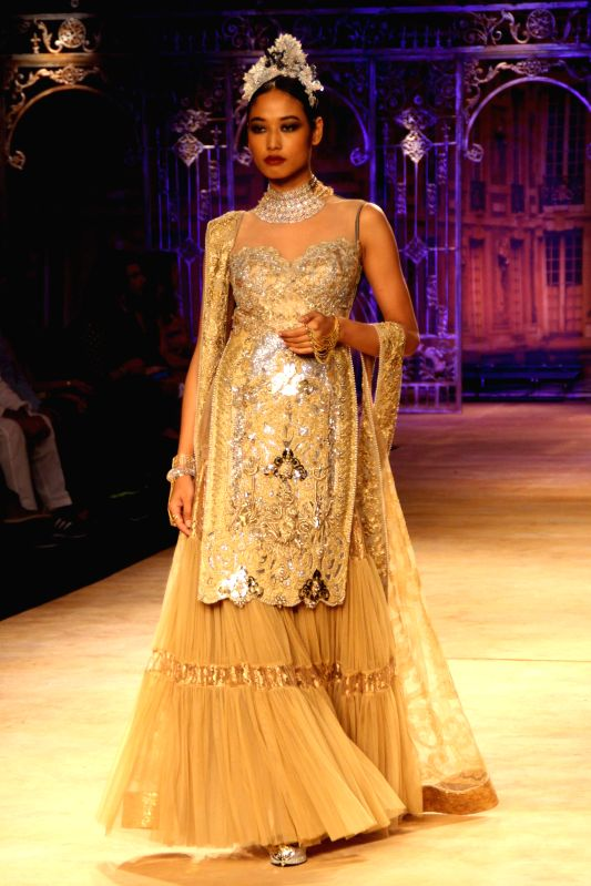 A model walks on the ramp for designer Sulakshana`s show during the India Couture Week 2014, in New Delhi on July 20, 2014.
