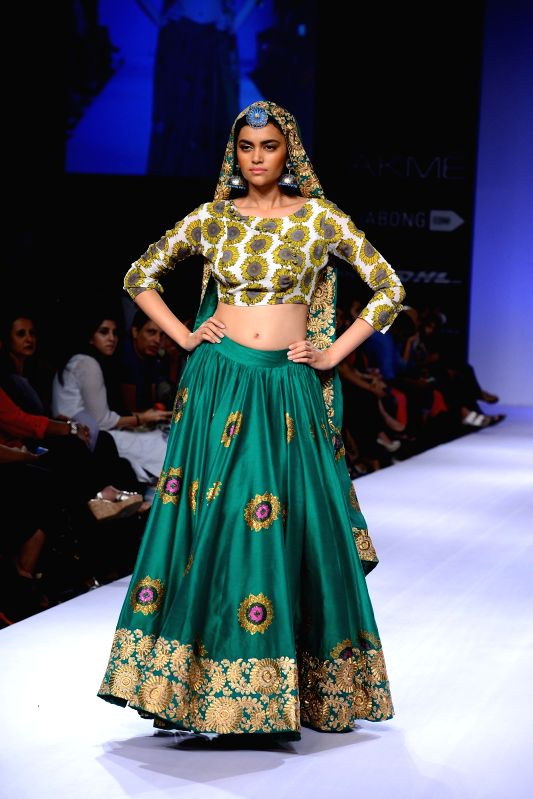A model walks on the ramp for designer Surendry during the Lakme Fashion Week (LFW) Winter/ Festive 2014 in Mumbai, on Aug. 20, 2014.
