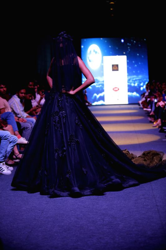 A model walks the ramp at the launch of Designer Mithi Kalra\'s new \'Moonlight Collection\' at the India Runway Week.