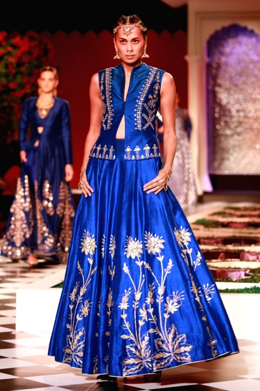 A model walks the ramp displaying an outfit by fashion designer Anita Dongre during the India Couture Week 2016, in New Delhi on July 21, 2016.