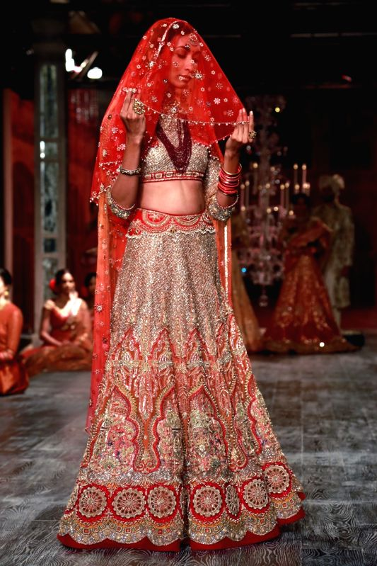 A model walks the ramp displaying an outfit by fashion designer Tarun Tahiliani during the India Couture Week 2016, in New Delhi on July 21, 2016.