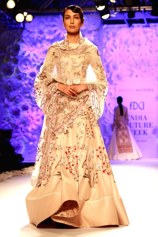 A model walks the ramp displaying an outfit by fashion designer Rahul Mishra during the India Couture Week 2016, in New Delhi on July 22, 2016. - Rahul Mishra