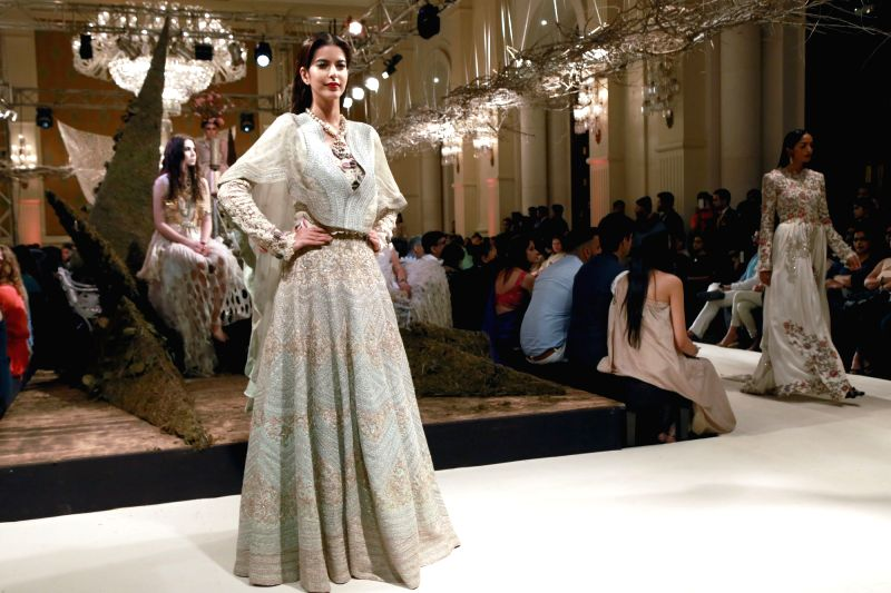 A model walks the ramp displaying an outfit by designer Anamika Khanna`s show during the India Couture Week 2016, in New Delhi on July 22, 2016. - Anamika Khanna