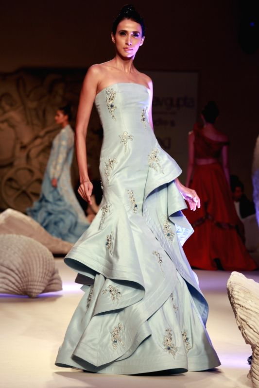 A model walks the ramp displaying an outfit by fashion designer Gaurav Gupta during the India Couture Week 2016, in New Delhi on July 23, 2016. - Gaurav Gupta