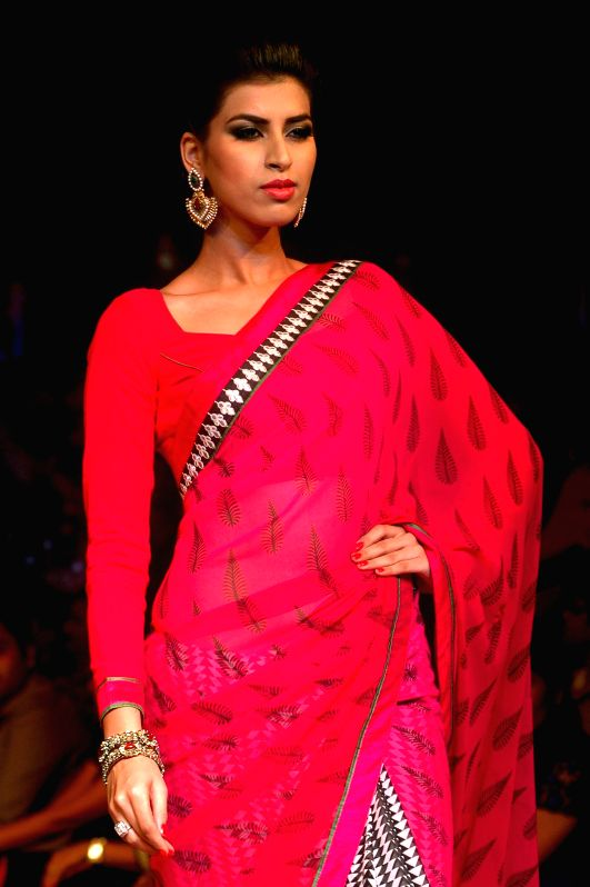 A model walks the ramp during a corporate fashion show in Kolkata on April 27, 2014.
