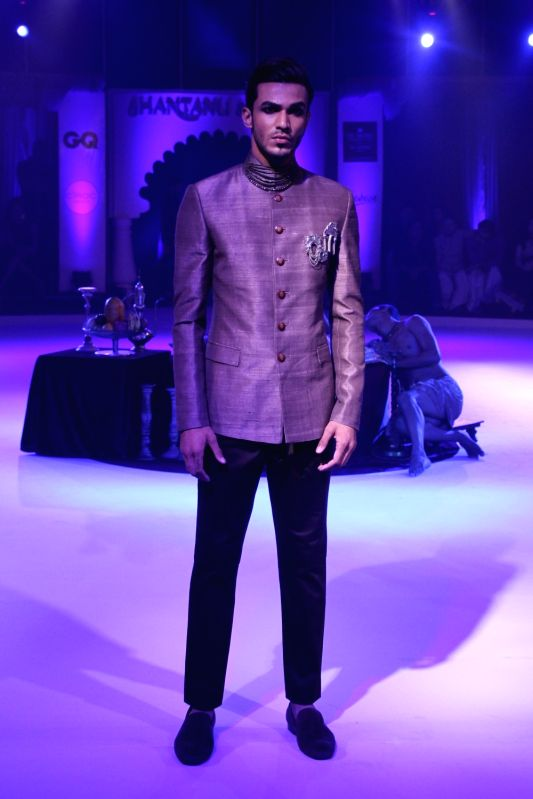 A model walks the ramp during a fashion show in Kolkata on Nov 15, 2015.