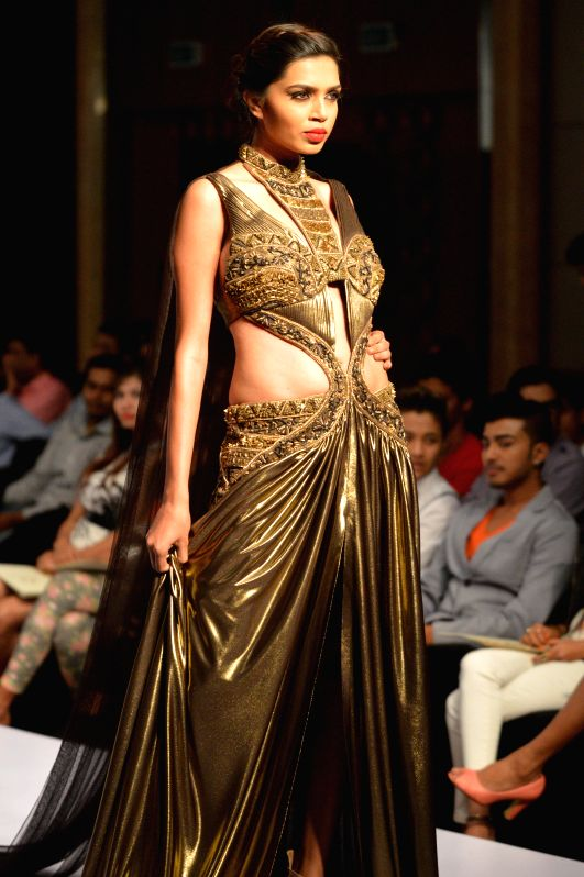 A model walks the ramp during Bangalore Fashion Week 2014, in Bangalore on Aug 8, 2014.