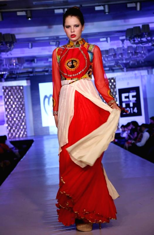 A model walks the ramp during `Fashion Fest 2014` in New Delhi.