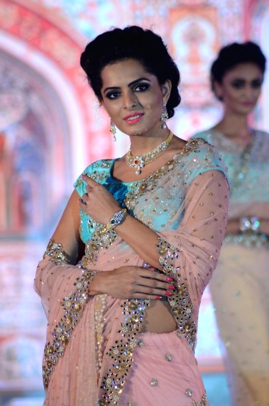 A model walks the ramp during GJF Fashion Nite by All India Gems & Jewellery Trade Federation in Mumbai on Aug 5, 2016.