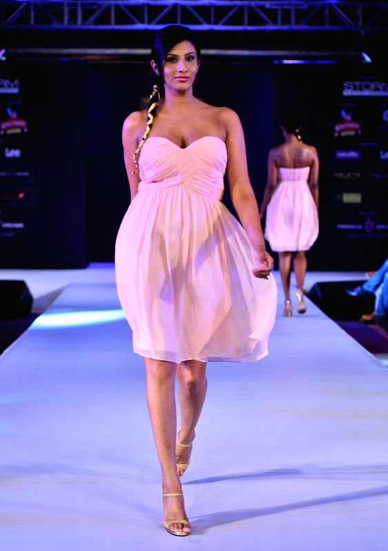 A model walks the ramp during the 6th edition of Kingfisher Premium Chennai International Fashion Week 2014 in Chennai on July 20, 2014.