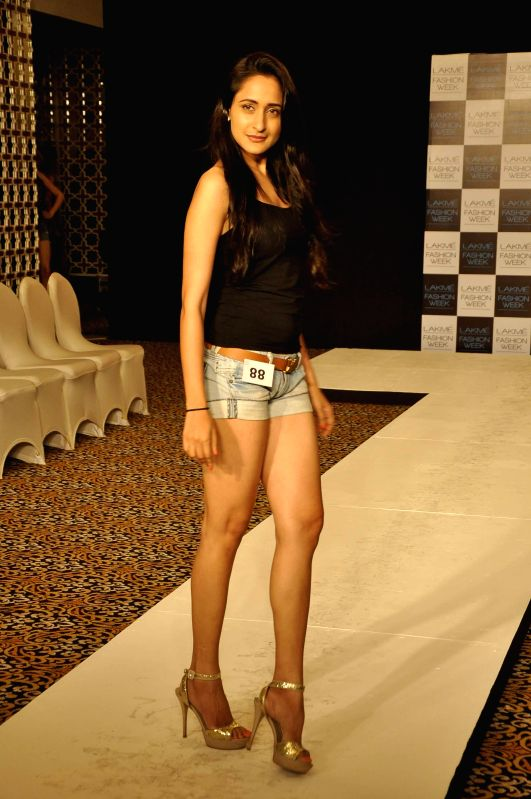 A model walks the ramp during the auditions for the Lakme Fashion Week, in Mumbai on July 3, 2014. The LFW Winter/Festive which is scheduled for August 22-24, 2014.
