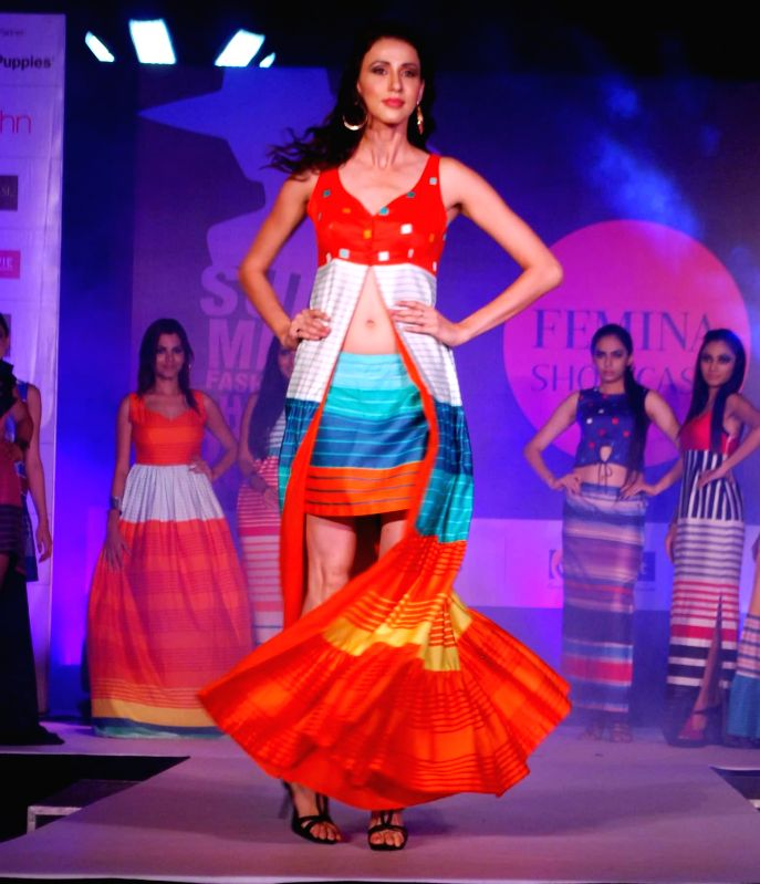 A model walks the ramp during the Femina Festive Showcase 2014 in Mumbai, on May 17, 2014.