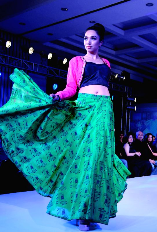 A model walks the ramp during the Kingfisher Ultra Style Week in Bangalore on July 25, 2014.