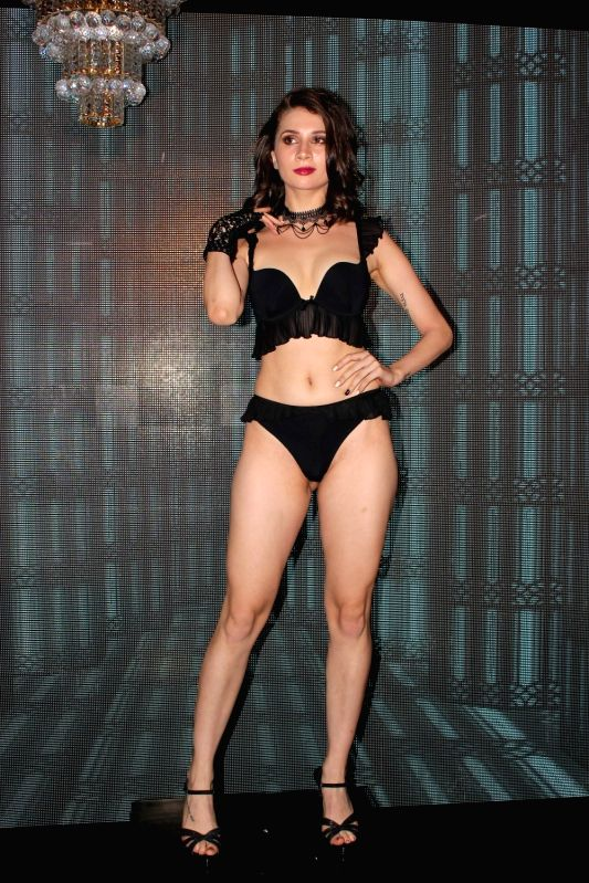 A model walks the ramp during the launch of brand Lingerie Shop in Mumbai on May 19, 2017.