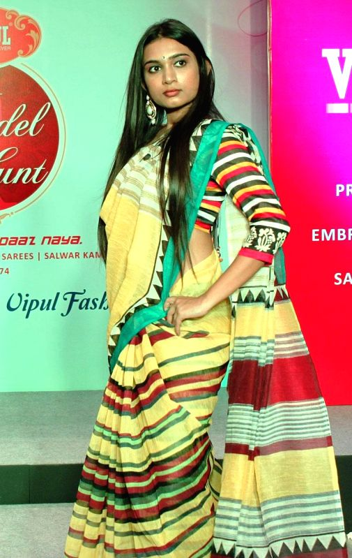 A model walks the ramp during Vipul Model Hunt in Bangalore on Aug 17, 2014.