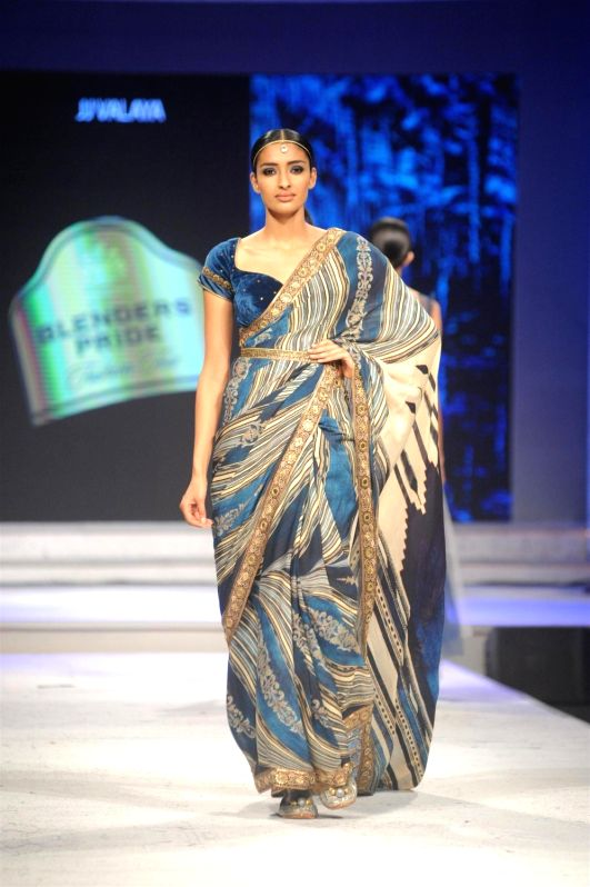 A model walks the ramp for designer JJ Valaya show at Blenders Pride Fashion Tour 2015 in Mumbai  on Dec 4, 2015.