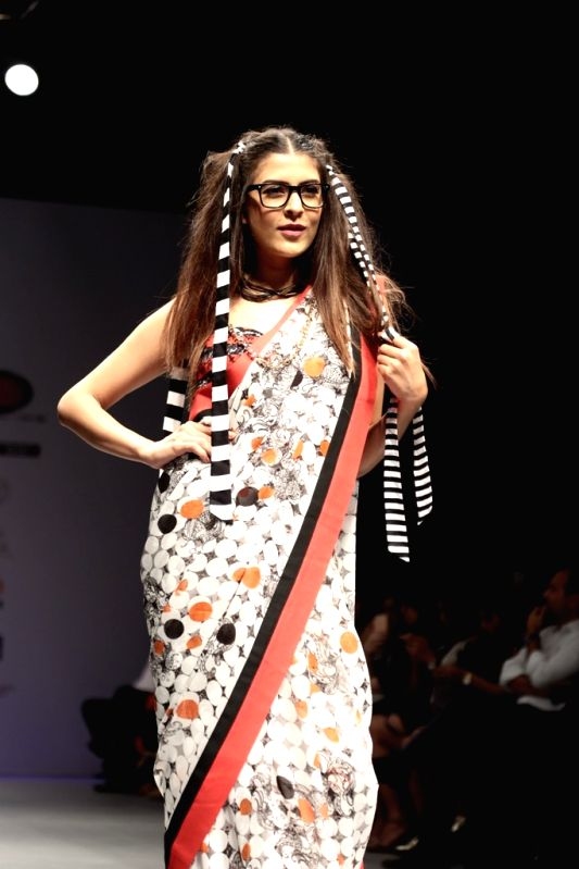 A model walks the ramp for designer Ken Ferns during India Runway Week Season 8 Summer/Spring at Thdyagraj Stadium in New Delhi on April 28, 2017.