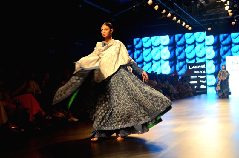 A model walks the ramp for fashion designer Gaurang Shah during the Lakme Fashion Week Summer/Resort 2018 in Mumbai on Feb 2, 2018. - Gaurang Shah