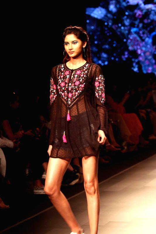 A model walks the ramp for fashion designer Ritu Kumar during the Lakme Fashion Week Summer/Resort 2018 in Mumbai on Jan 31, 2018. - Ritu Kumar