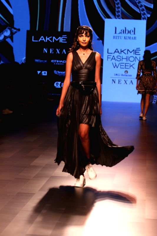 A model walks the ramp for fashion designer Ritu Kumar during the Lakme Fashion Week Summer/Resort 2018 in Mumbai on Jan 31, 2018. - Ritu Kumar