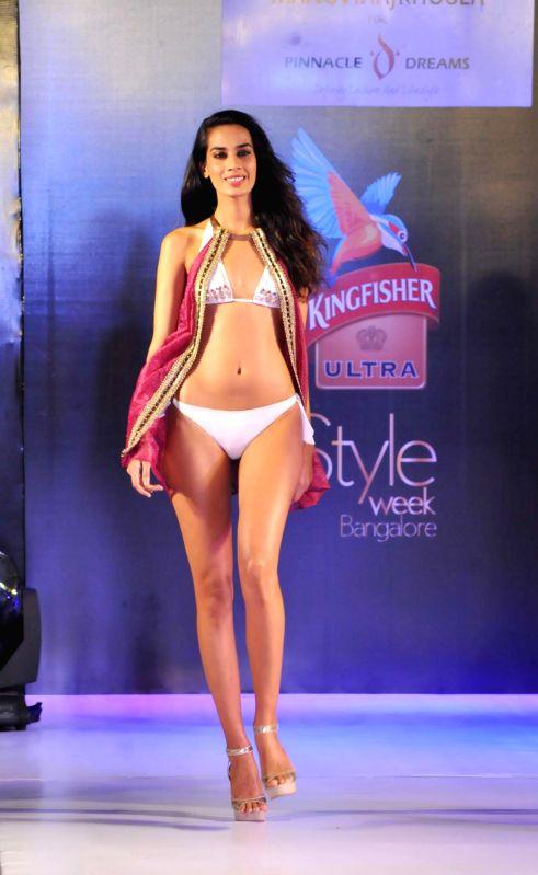 A model walks the ramp showcasing creations of fashion designer Sanjana Jon during Kingfisher Ultra Style Week Bangalore 2014 on July 27, 2014.