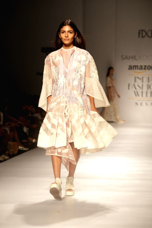 A model walks the ramp showcasing the creations of fashion designer Sahil Kochhar at Amazon India Fashion Week Summer Spring in New Delhi, on Oct 12, 2017.