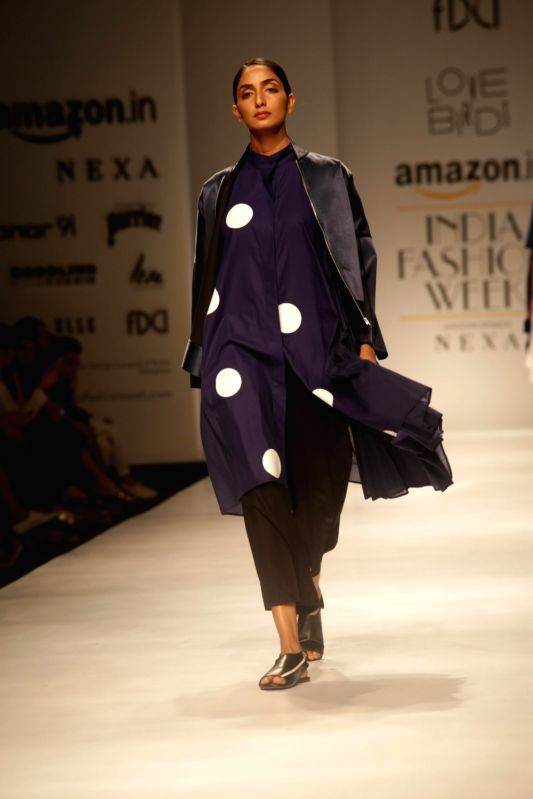 A model walks the ramp showcasing the creations of Lovebirds at Amazon India Fashion Week Summer Spring in New Delhi, on Oct 12, 2017.