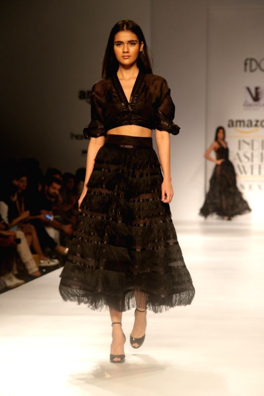 A model walks the ramp showcasing the creations of fashion designer Nikita at Amazon India Fashion Week Summer Spring in New Delhi, on Oct 12, 2017.