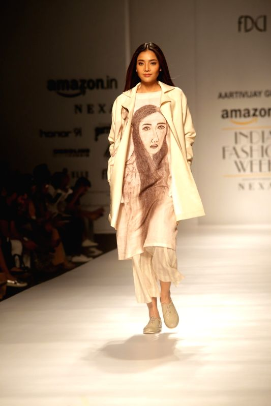 A model walks the ramp showcasing the creations of fashion designer Aartivijay Gupta at Amazon India Fashion Week Summer Spring in New Delhi, on Oct 12, 2017. - Aartivijay Gupta