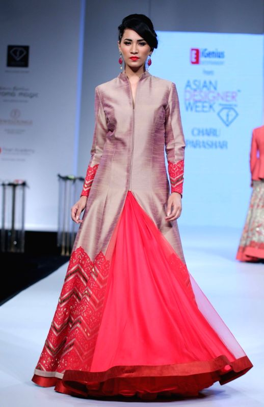 A model walks the ramp to showcase designer Charu Parashar`s collection at Asian Designer Week 2015 in New Delhi, on Oct 31, 2015.