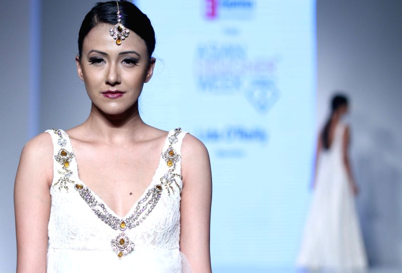 A model walks the ramp to showcase designer Lida O`Reilly`s collection at Asian Designer Week 2015 in New Delhi, on Oct 31, 2015.