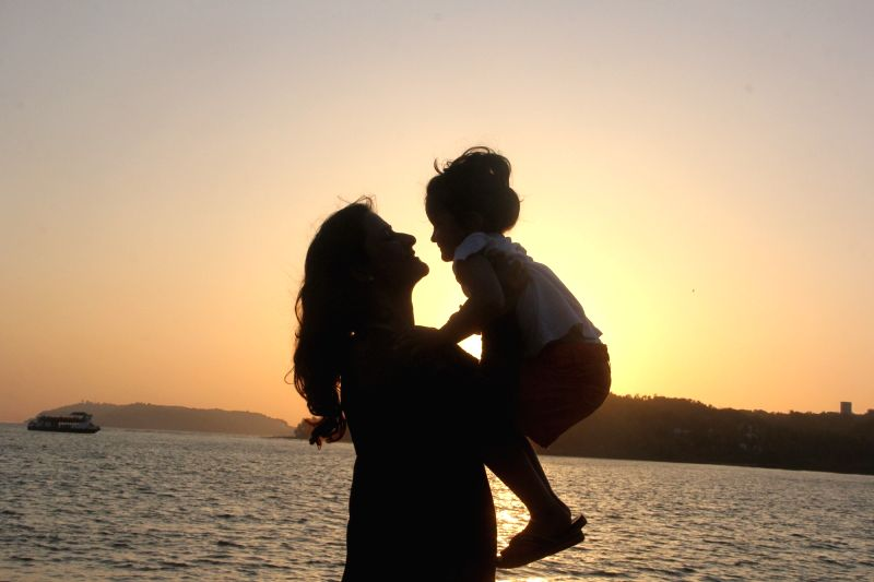 A mother and her daughter enjoy the sunset on the eve of Mothers Day celebration in Panaji on May 7, 2016.
