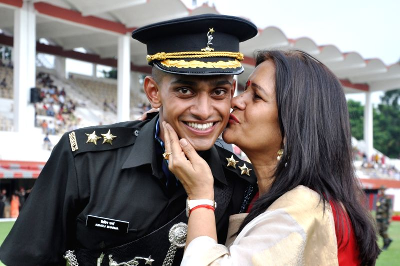 A newly commissioned Indian Army officer shares a warm moment with his mother during his Passing Out Parade at Indian Military Academy (IMA) in Dehradun on June 9, 2018.